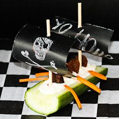 """You can also make some Pirate Ships as a healthy party food option: cutting pieces of celery and filling them with cream cheese, threading toothpicks through small piece of paper sails and inserting into the celery sticks and don't forget to put some """"pirates"""", raisins will do the trick."""