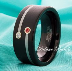 This is what his ring will look like. Mine will be silver and smaller. Ruby is his birthstone and mine is diamond