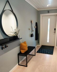 A big round mirror in the hallway will add more depth, meaning your home will fe. - A big round mirror in the hallway will add more depth, meaning your home will feel bigger – and y - Decoration Hall, Entryway Decor, Apartment Entryway, Wall Decor, Decorations, Apartment Ideas, Entryway Bench, Home Design, Home Interior Design