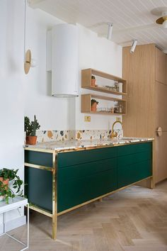 Terrazzo Is Trending: These Five Rooms Show Exactly Why. Bright minimalist kitchen with statement Art Deco cupboard featuring a marmoreal terrazzo surface Decor, Kitchen Interior, Interior, Terrazzo, Home Decor, House Interior, Trending Decor, Minimalist Kitchen, Interior Design