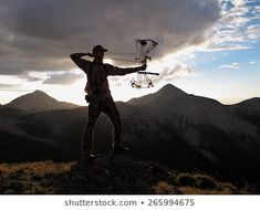 bow hunter silhouette with dramatic landscape Bow Stabilizer, Royalty Free Images, Royalty Free Stock Photos, Bow Hunter, Bow Accessories, Hunting Season, Mount Everest, Dating, Bows