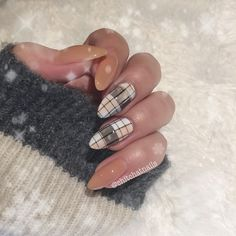 Black and white plaid nail w a faint wide swipe of color