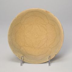 Lobed Dish with Overlapping Lotus Leaves, late Tang dynasty (618–907) or Five Dynasties period (907-960), 9th century. Yue ware; stoneware with pale olive-green glaze and underglaze incised decorat...