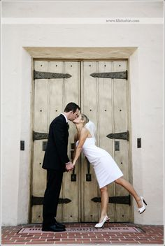 Such a cute kiss in front of one of the mission doors!