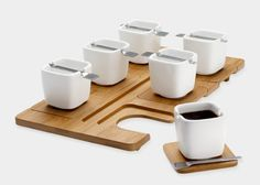 Designy espresso set: Parisian designer Fellina Sok-Cham dreamed up this perfect espresso-serving set, with a bamboo tray that dismantles to become individual saucers for six hip-to-be-square demitasse cups. Tiny notches that act as spoon rests in the cups' top rim is a clever touch.