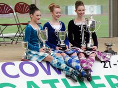 The three Highland Dancing World Champions for 2015. Juvenile: Erin Blair (USA), Junior: Ellis Hayes (Canada) and Adult: Marielle Lesperance (Canada).