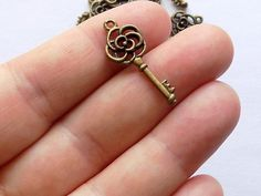 10 Rose Key Charms Pendants B0011 by StashofCharms on Etsy
