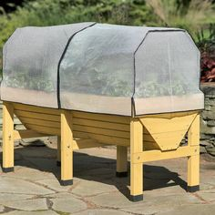 VEGTRUG™ PATIO GARDEN WITH COVERS Grow a productive vegetable garden in a small space  The VegTrug™ is the winner of the 2012 Green Thumb Award for Outstanding New Product!  From Gardener's Supply Company