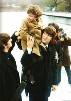 February 8, 1964, meeting photographers in Central Park.