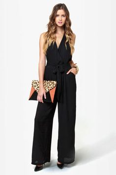 Check it out from Lulus.com! Add some sexy stilettos to the Along for the Stride Backless Black Jumpsuit and pretty much everyone will be trying to keep in step with you! This stylish one-piece features silky woven Georgette that wraps into a surplice bodice and fastens with two buttons at the back of a halter neckline. Attached waist ties wrap around and tie at front. Wide-leg pants. Invisible back zipper. Lined to mid-thigh. Bodice and legs are slightly sheer. Model is wearing a size…