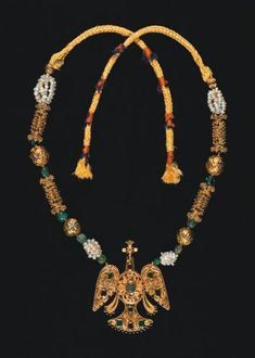 Morocco | Gold filigree bird pendant set with precious stones, combined with baroque pearls, four cylindrical gold filigree beads, four gold beads with enamel, and emeralds | 15 000€ ~ sold (Dec '09)