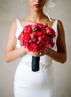 Fabulous red bouquet using red roses, garden roses, and sweetheart roses. Perfect!