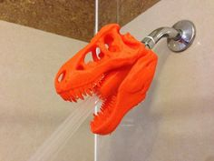 However, thanks to 3D printing, we have seen several very unique looking shower heads pop up on websites like Thingiverse and Shapeways. One designer, JMSchwartz11, took the original T-Rex head, and turned it into a brilliant shower head design. This will fit any standard 1/2″ shower head pipe, and should hold up nicely. Just be sure to warn your guests before they step into the shower!