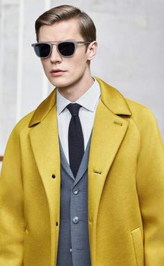 Yellow coat, grey suit, white shirt and black neckwear by BOSS