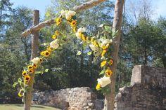 Costley mill park, Conyers ga. Hydrangeas, sunflowers, blue wax flower. EMW florals, monroe GA. Wedding garland and shotgun shells.