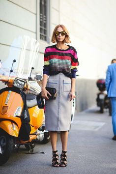 Vespas make great accessories. #refinery29 http://www.refinery29.com/2015/09/94857/milan-fashion-week-spring-2016-street-style-pictures#slide-16