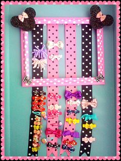 This is a handmade Painted frame customized its a 10x12 with Polka Dot ribbons is 20 inch long Minnie mouse hair bow holder it can hold 25 or more of my big 5 inch hair bows. The Minnie mouse is pink Polka Dots with black Black Polka Dots there are 4 rows of Polka dot ribbon that matches Minnie .Its a Great Gift for any little girl that loves Minnie Mouse.It is designed to keep bows and barrettes organized.By Jessy G Soon ..