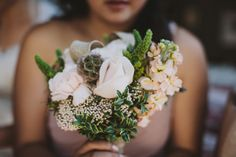 Soft shades of pink with plenty of greenery and burlap were used in these rustic bridesmaid bouquets. The soft pink complements the dusty rose bridesmaid dresses. Photo courtesy of Sean Flanigan Photography. Bridesmaid bouquet by Seasonal Celebrations.