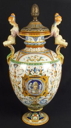 """GINORI ITALIAN MAJOLICA VASE. Ginori large Italian majolica vase with lid, Renaissance Pompeian style classical decoration, front cartouche with portrait of Annibale, verso with portrait of Achille, side cartouches with fantasy animal, female grotesque form handles. Marked: (crown) Ginori 341 2. (old paper label) Chas Reizenstein China and Glass, Pittsburg, Pa. Size: vase: 22 3/4""""H, vase with lid: 24 1/2""""H, 12 1/2""""W. widest part, 6"""" base diameter."""