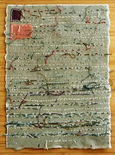 Patti Roberts-Pizzuto -- Lost Page Fragment  Embroidery and collage on handmade paper dipped in beeswax...reminiscent of a long lost page of text