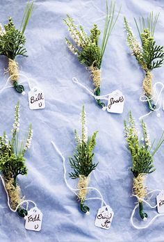 Hand-tied Boutonnieres for a Rustic Wedding white pine needles, sphagnum moss, and white heather.