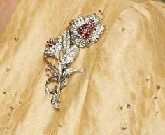 Hibiscus Brooch. A gift to Queen Elizabeth the Queen Mother from Australia, this brooch depicts two diamond Australian hibiscus flowers with ruby centers.