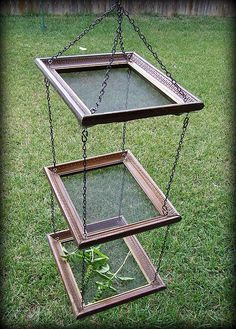 Picture frame + screen + chain = Herb, fruit or veggie dryer...or as a rack for drying painted papers, other art projects. Platform feeder for birds. Imagination go wild.