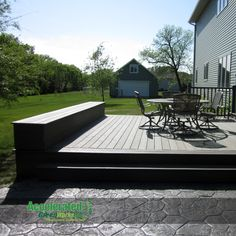 A fixed seating bench caps off the end of the new deck platform.  Storage is accessible from the end for easy access to children's toys and creates a spot for comfortable seating cushions on top (can be changed out seasonally).
