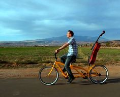 Well looky there. Steve. On a tandem bike. With his cello. Now isn't that absolutely. adorable.