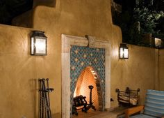 Moroccan style outdoor fireplace by designer Kenneth Walker.