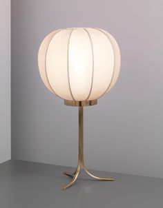 JOSEF FRANK Table lamp, 1950s Brass, fabric shade. 58 cm (22 7/8 in) high Manufactured and retailed by Svenskt Tenn, Sweden. Underside with manufacturer's paper label 'S'. #lighting