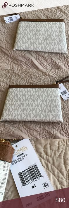 Xl zip clutch Xl zip clutch  authentic Michael Kors Bags Clutches & Wristlets