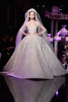 Elie Saab is a Lebanese fashion designer. There's no denying that Elie Saab is extremely good at what he does: he makes dress dreams come true. White Wedding Gowns, Couture Wedding Gowns, Wedding Dresses 2014, Gorgeous Wedding Dress, Couture Dresses, Beautiful Gowns, Bridal Dresses, Dream Wedding, Elie Saab Haute Couture