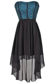 Adorable dark teal-ish dress...love the cut of the skirt, and the corset-like look of the top.