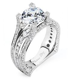 From Michael M. Collection Handcrafted platinum Engagement Ring featuring strings of diamonds, graduating channel-set diamond details and diamond-tipped prongs. Also available in 18k white, yellow and rose gold.