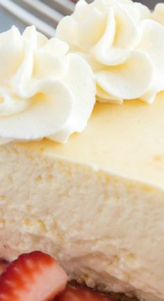 The Best Vanilla Cheesecake ~ This Vanilla Cheesecake is super creamy and not as heavy as traditional baked cheesecake thanks to a good dose of sour cream or Greek yogurt — it's soft and luscious and perfect with fresh berries!