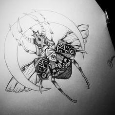 Scarab beetle tattoo