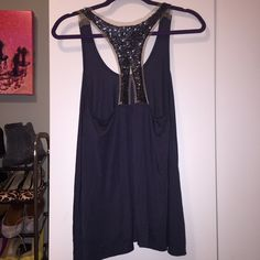 Eight Sixty Beaded Racerback Asymmetrical Tank Sequin Racerback tank with sheer underlay. Tank is navy with asymmetrical hem. Scoop neck. Some sequins on the shoulder are loose, but it's camouflaged well. Overall great condition aside from the few loose sequins! Eight Sixty Tops