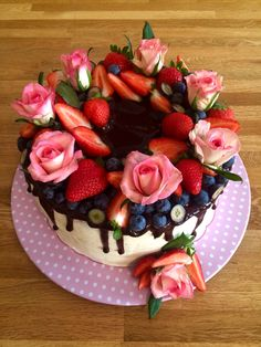 Birthday cake with chocolate, fruit and rose