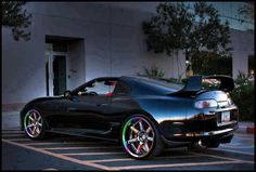 Toyota supra with rainbow mags. sharp lil' ride