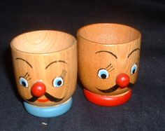 pair of wood head egg cups.  via Etsy.