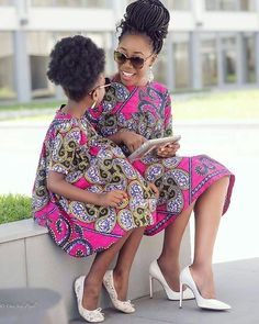Ankara won't stop surprising with it's lovely styles and designs. Below in our gallery are hottest and trendiest Ankara styles for mums and their daughters. Couples African Outfits, African Dresses For Kids, African Attire, African Babies, African Children, African Wear, African Print Dress Designs, African Print Fashion, Ankara Fashion