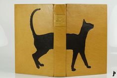 The Cat Who Walked through Walls. Hand bound by Jason Patrician. Covered in Harmatan Yellow 30 goat leather, with Chocolate goat onlays. Hand sewn silk headbands, hand marbled endpapers, and blind-tooled.