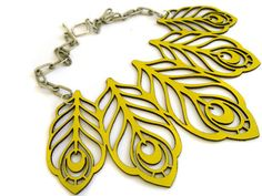 Laser cut leather peacock feather necklace by EmilydeMolly.    Yellow is for rock stars.
