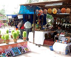 <center>Delhi's Top Shops</center> Delhi Shopping, India Shopping, Delhi Haat, States Of India, Craft Markets, Printed Linen, Agra, Embroidery Techniques, Travel And Leisure