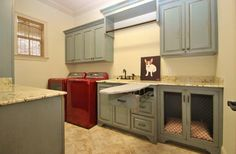I love the blue cabinets for a laundry room with gold accented antiqing
