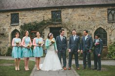 brides and bridesmaides in duck egg blue
