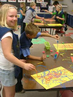 Pollock paintings with strings on clothespins- this class made guitars and tied to career of graphic artist. Love'em!