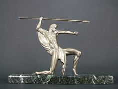 The Warrior by Decoux  Silvered bronze stylised warrior statue. Made by the Belgian artist Michel Decoux 1837 - 1924 and signed in the bronze to the back. Mounted on a verdigris marble base that measures 14 inches long by 3 deep and the total height of the statue is approx. 11 inches (36cm x 7.5cm x 28cm). Condition is very good with some expected ageing to the patina.