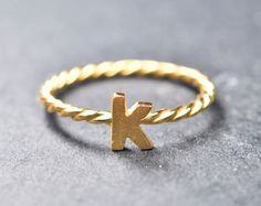Custom initial ring, letter ring, alphabet ring, sterling silver, personalized ring, heart ring, name ring, gold plated. $63.00, via Etsy.